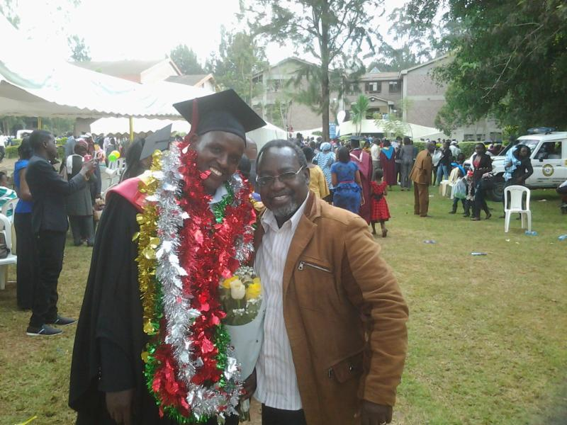 Joseph standing with our regional director Rev. Benson Mutisya at his graduation.